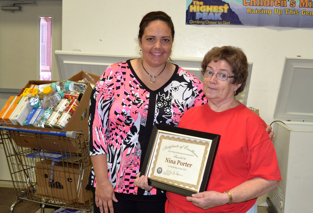 The Food Bank Agency Relations Coordinator Barbara Borntrager honors longtime Lewis County Food Pantry director Nina Porter. The pantry will continue next month at a new location in Canton.