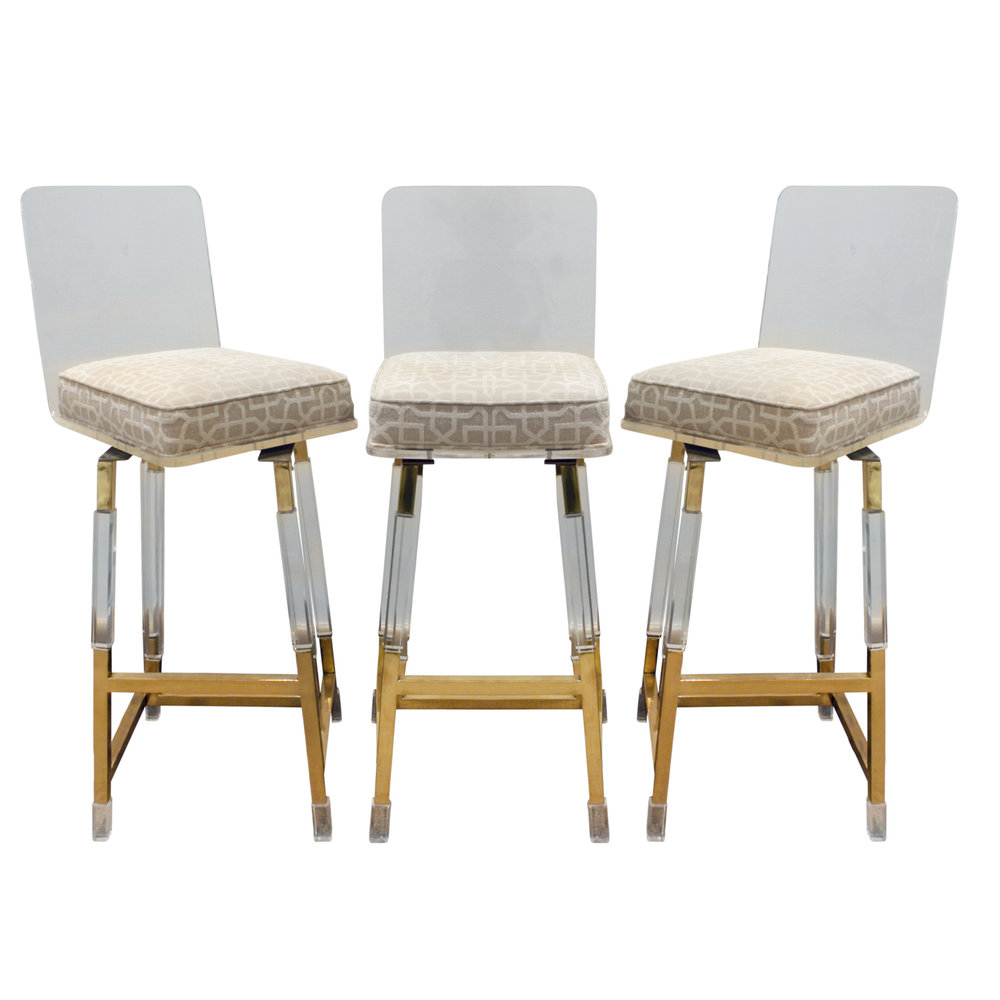 Set of 3 swiveling bar stools in lucite and brass with upholstered seat by charles hollis jones metric line american 1970s these are newly upholstered