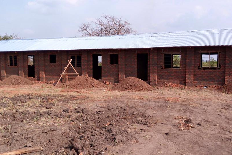 The secondary school before it was finished. The floor and walls have been finished but there is some ongoing work that needs to be done to the building before it is complete.