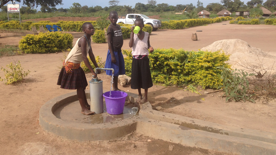 pumping water at the well.jpg