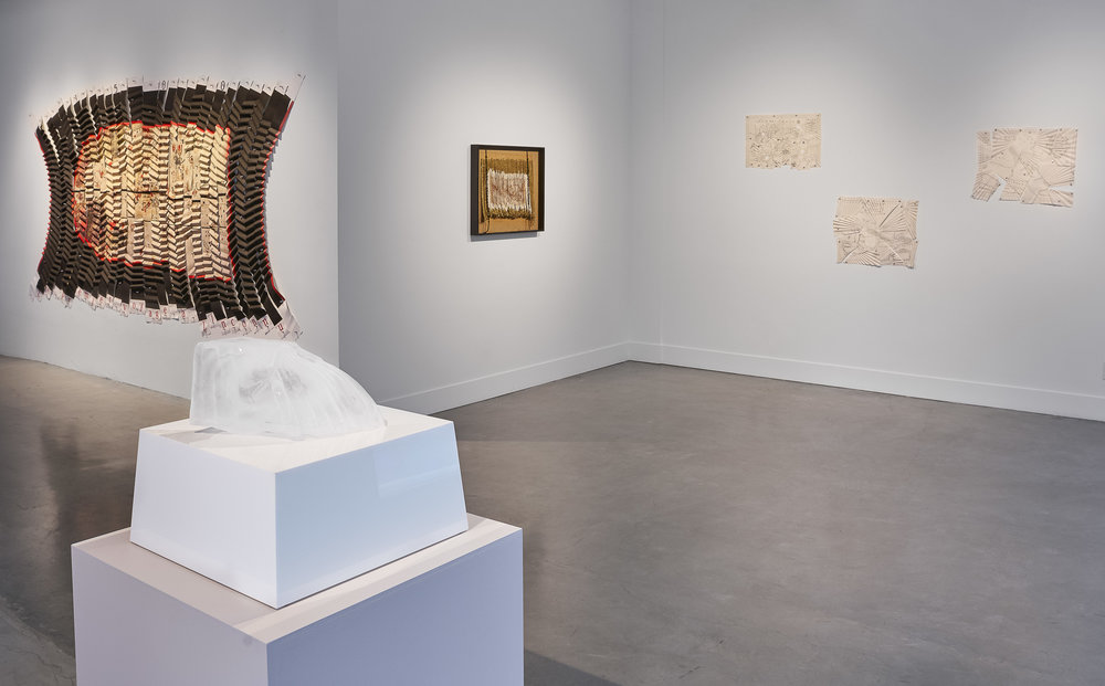 Exhibition documentation of Adrien Segal,  Grewingk Glacier , 2017, glacier water (2.25 gallons), unique silicon casting mold with two-part mother mold, and custom stone plinth with watch catchment. Miguel Angel Ríos work on far wall. Image courtesy of the artists and Gallery Wendi Norris, San Francisco.