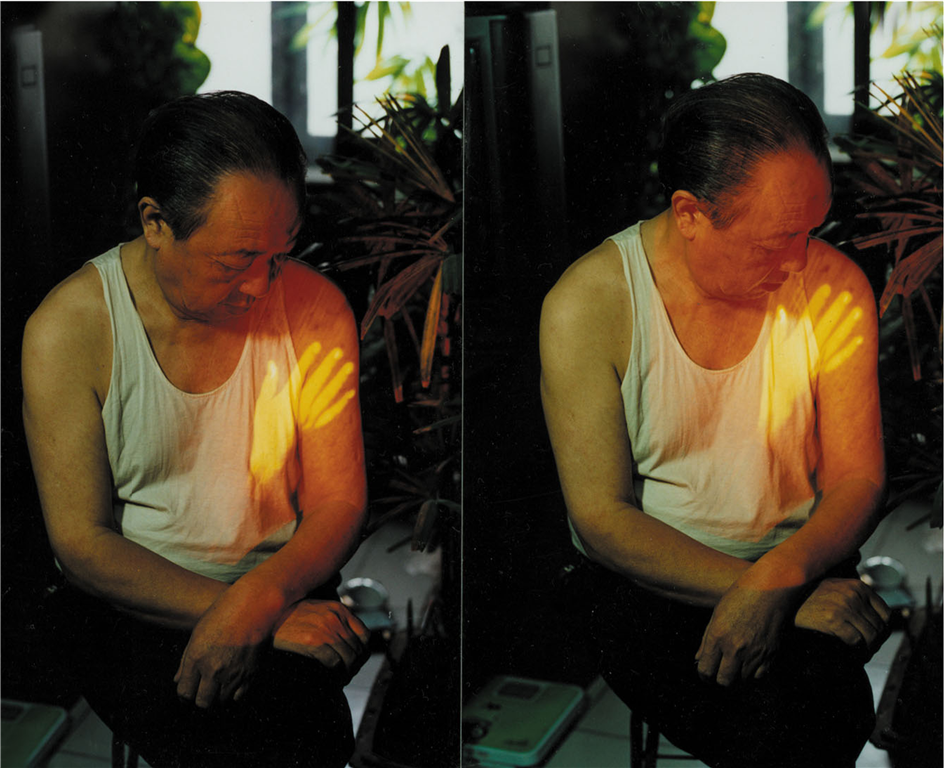 Song Dong,  Touching My Father , 1997, Videotape, performance. Image accessed via Asia Art Archive.