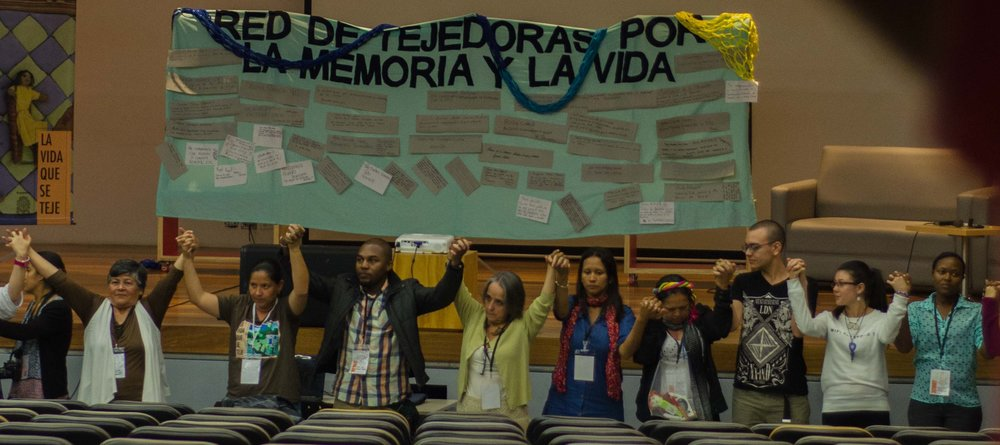 Some of the weavers representing their different regions together in Medellín to build the  Red de Tejedoras por la Memoria y la Vida  / Network of Weavers for Life and Memory. Photo by Sara Castillejos, Focos Narrativos.