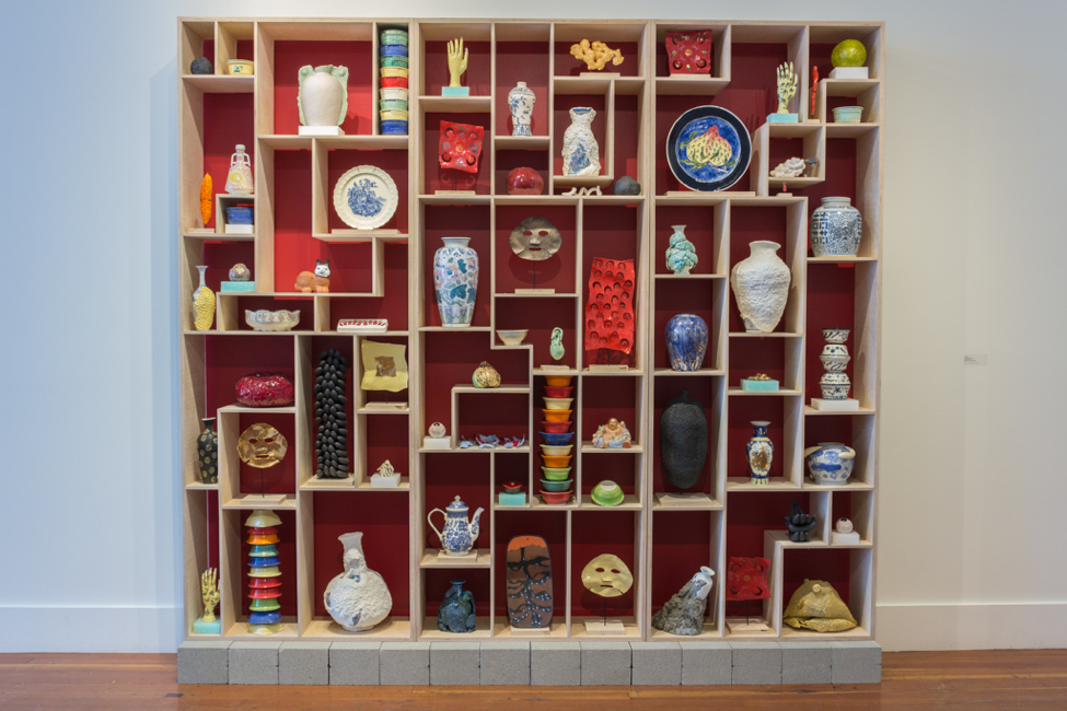 Cathy Lu,  Treasure Case , 2016, ceramic, wood, concrete blocks, 102 x 108 x 16 in. Image courtesy of the artist.