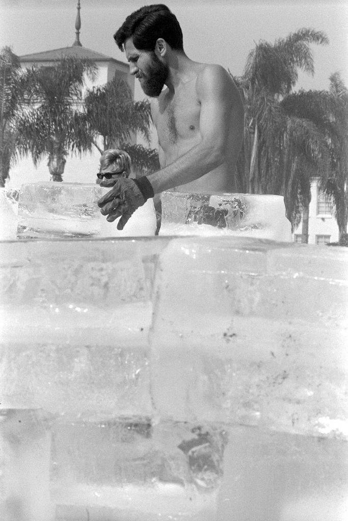 Allan Kaprow placing an ice block during the creation of  Fluids  (1967). Image from the collection of the Los Angeles County Museum of Art. Photo copyright of Dennis Hopper.