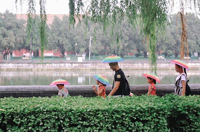 Family is everything, and you get extra points for matching umbrella hats. #beijing