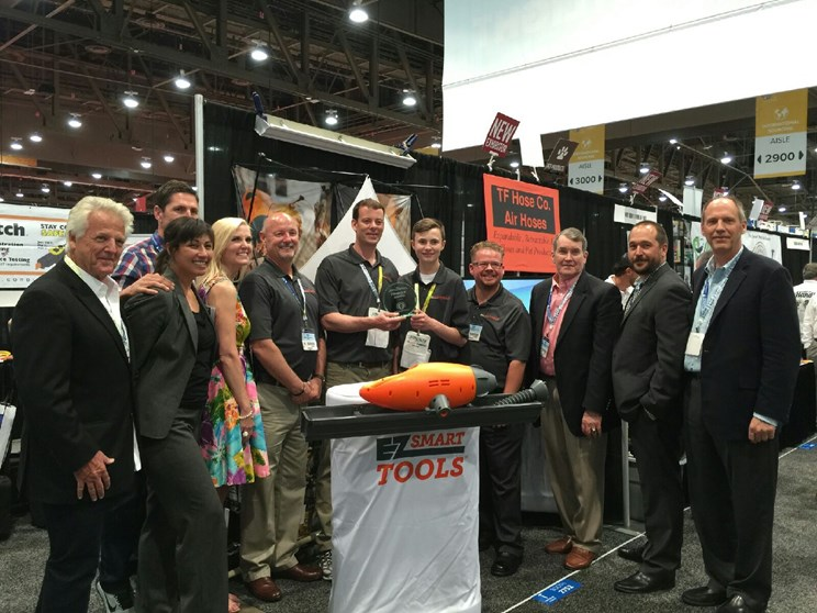 The EZ Smart Team receiving the Pinnacle Award for Best Overall Product at the 2015 National Hardware Show.