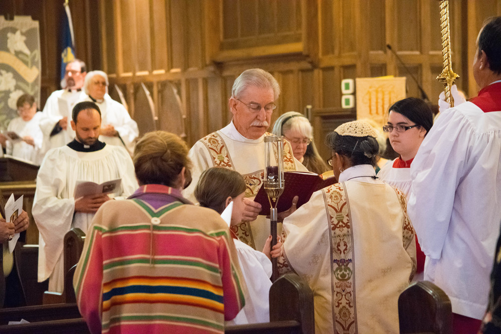Deacon Bill reads the Gospel from the aisle.