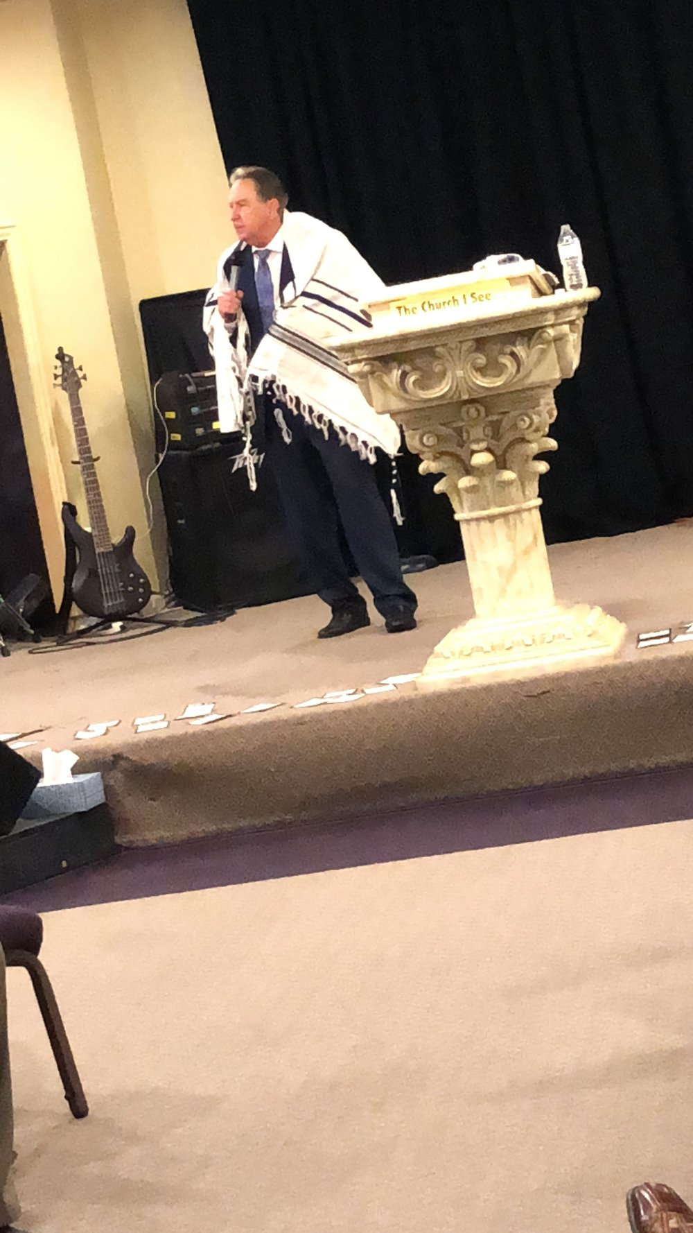 Corinth, Texas; Winslow preaching with prayer shawl.