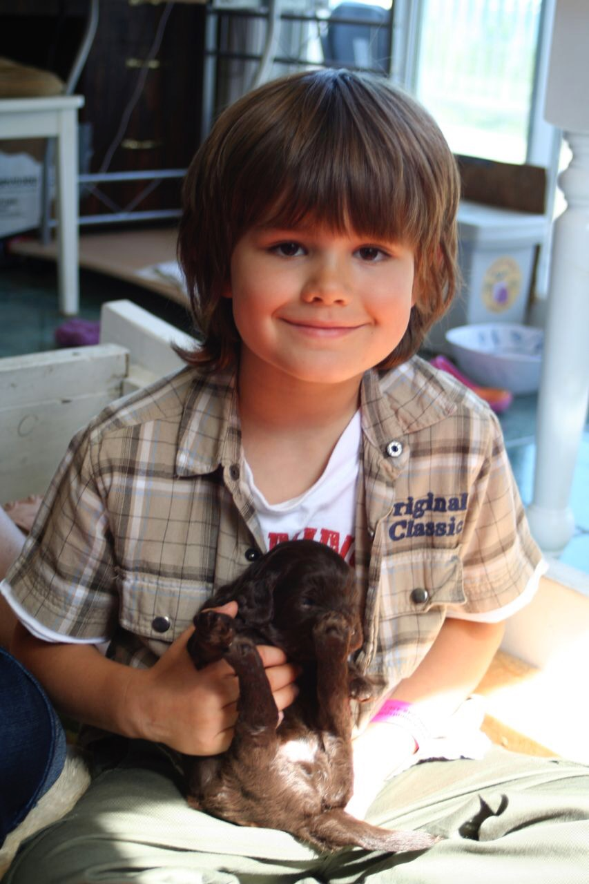 This is the day Dylan chose Cooper at Labradoodles By Design. He was the biggest and chubbiest of 9 puppies!