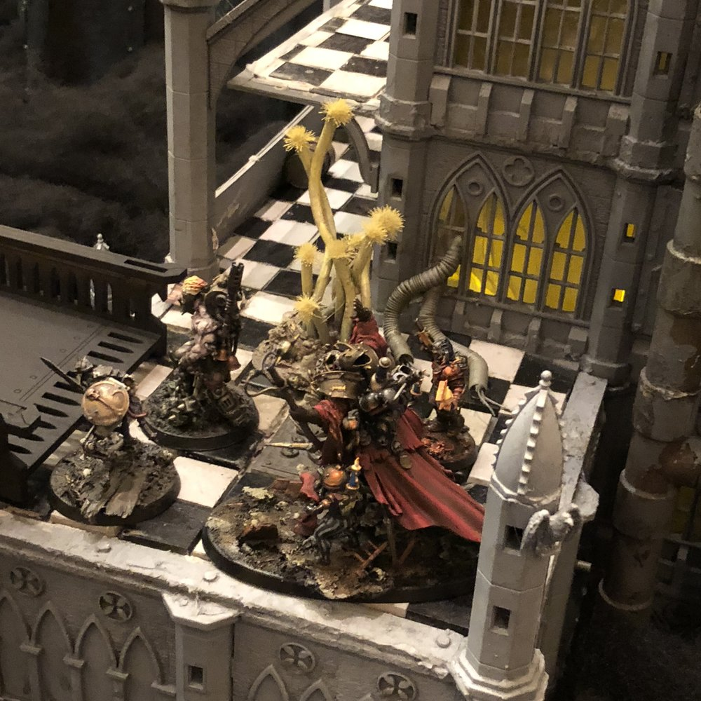 "A portion of D. Vogel's Cohort, created by V. Michael, penitents, and myself , Inquisitor Amindian Galdiciti ""The Great Chamber"" and his torchbearer acolyte Kar'ral, pictured here anticipating actions to support or defend themselves from the actions of their Daemonhost Saint Marchesa and her bird minions."