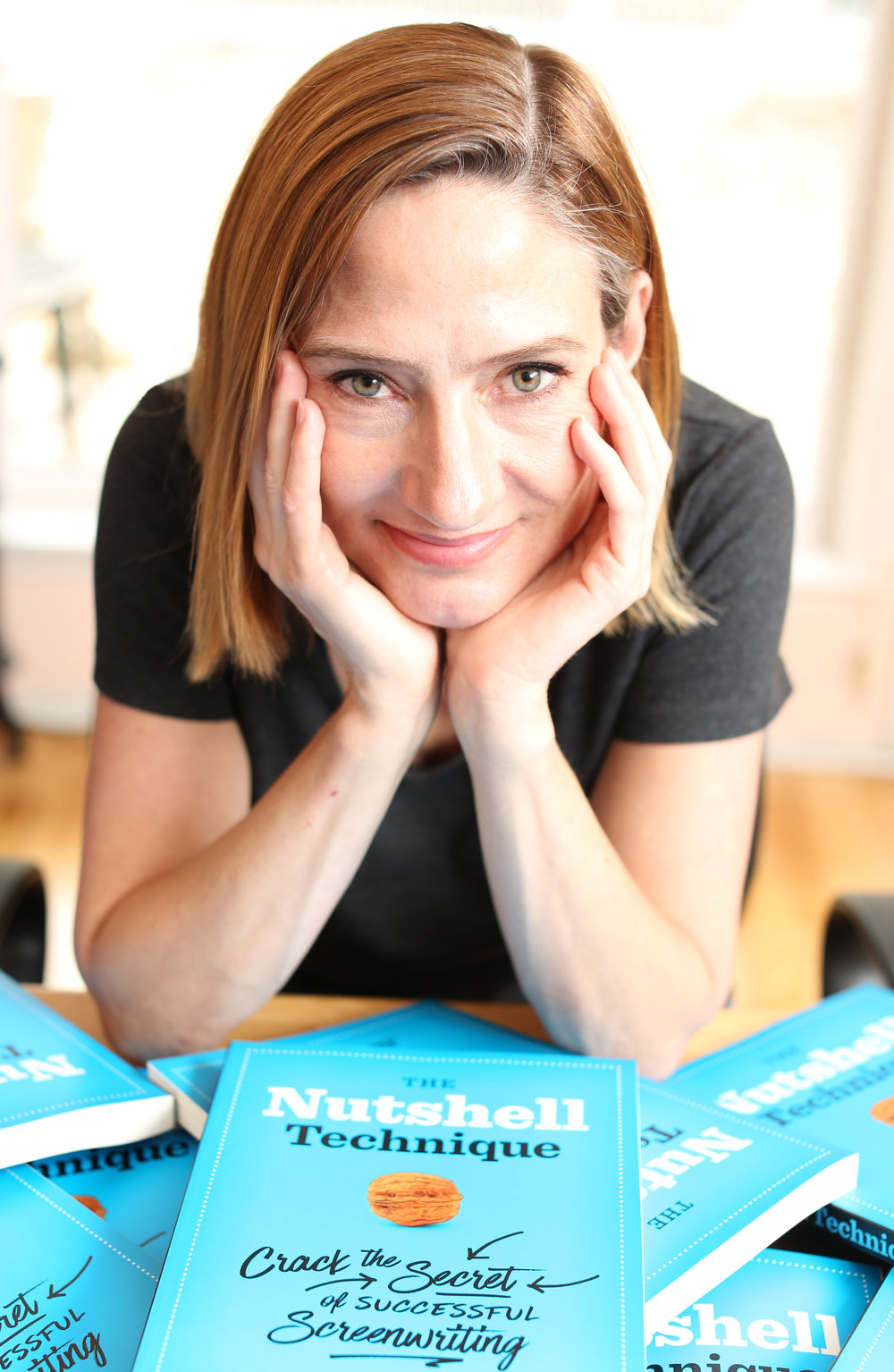Jill press photo w books.jpg