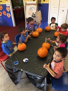 painting our pumpkins