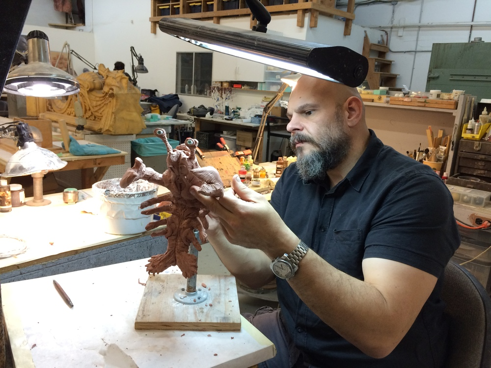 Gabe Bartalos hard at work sculpting the newborn creature puppet's design...