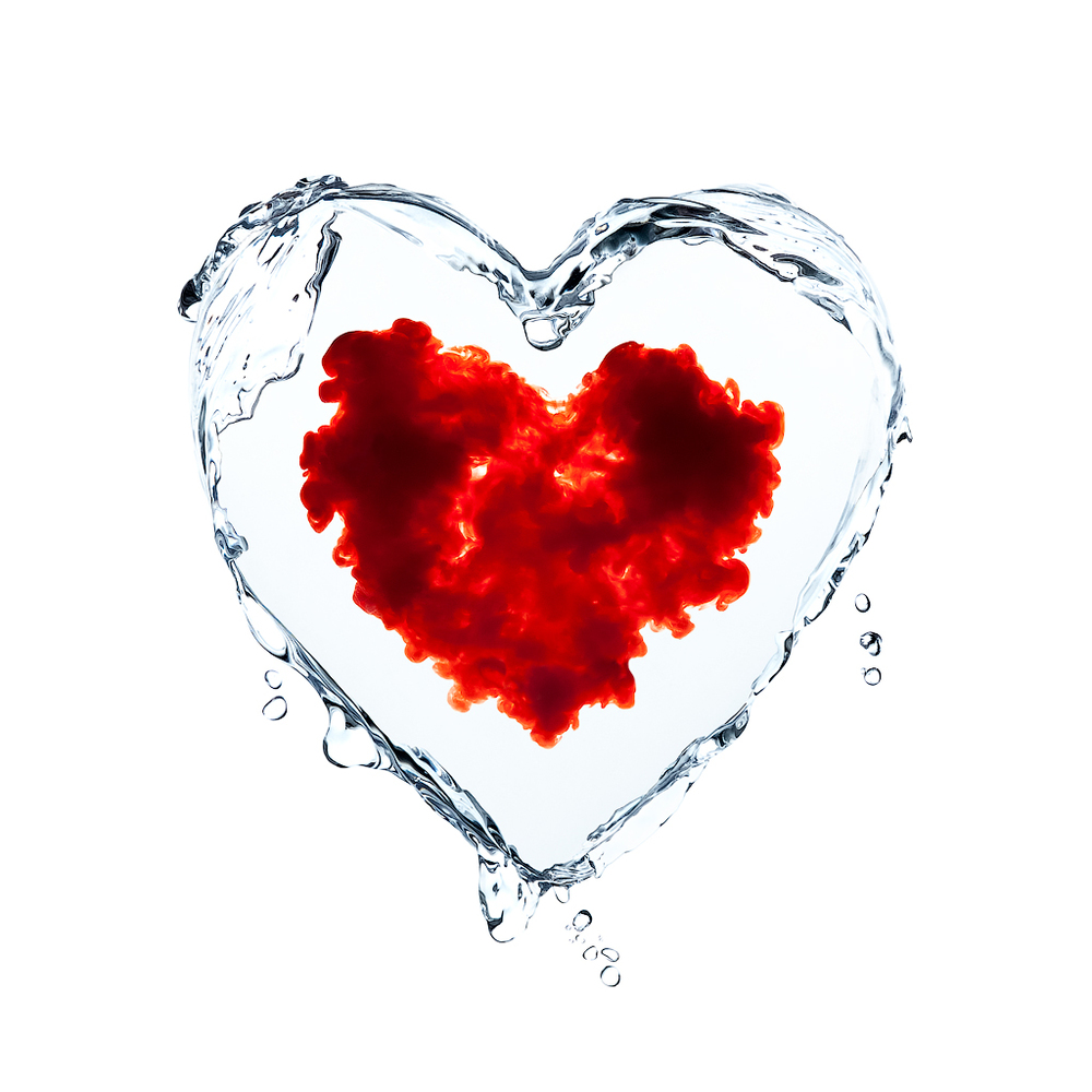 A composite image of a transparent liquid heart, with a cloud of red liquid forming within