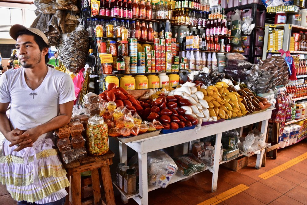 In the market - Walarao García stands by his family's market stand, which he has grown over the last seven years.