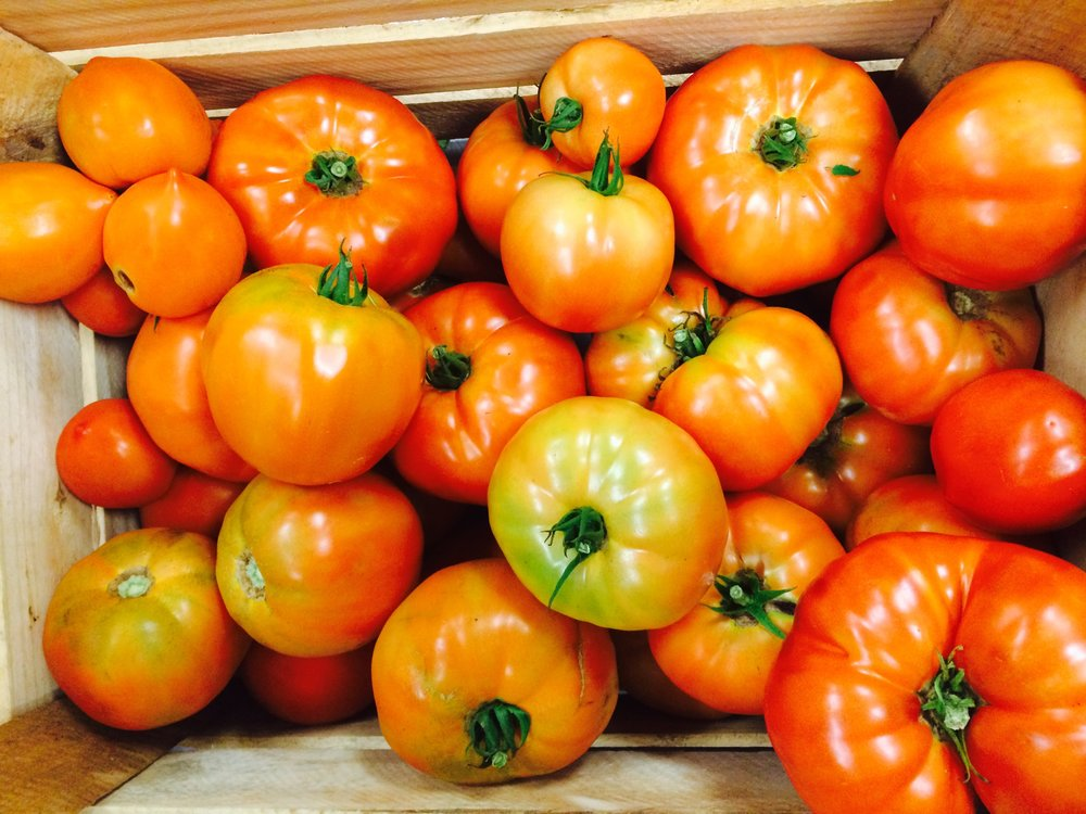 crate of beefsteak tomatoes