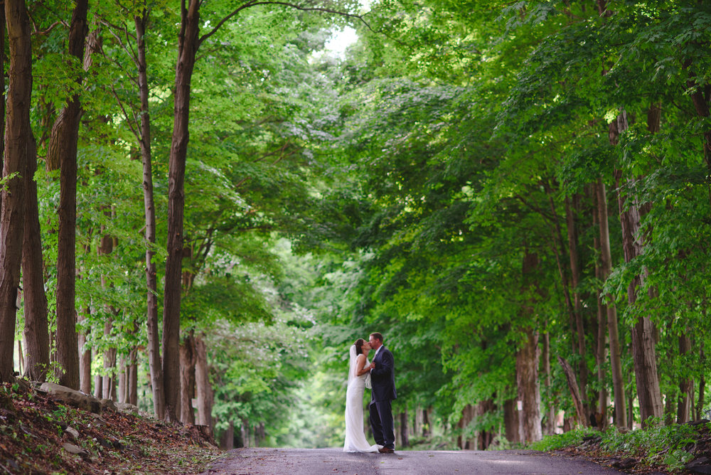 couple kissing on burroughs drive in the summer