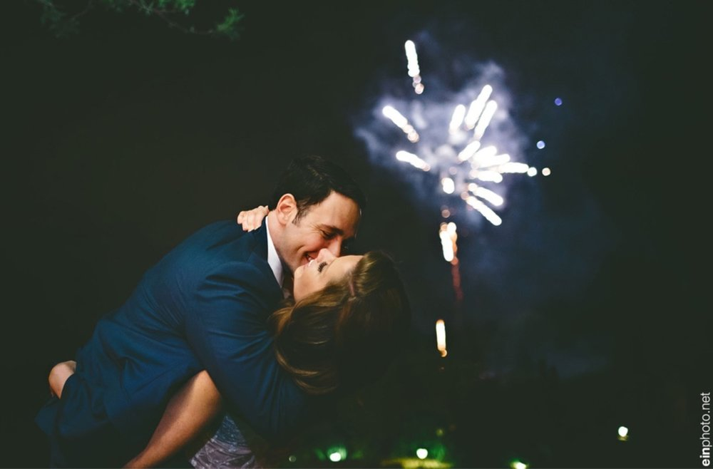 kissing under fireworks