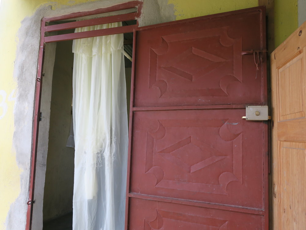 A fabricated metal door helps secure a home.
