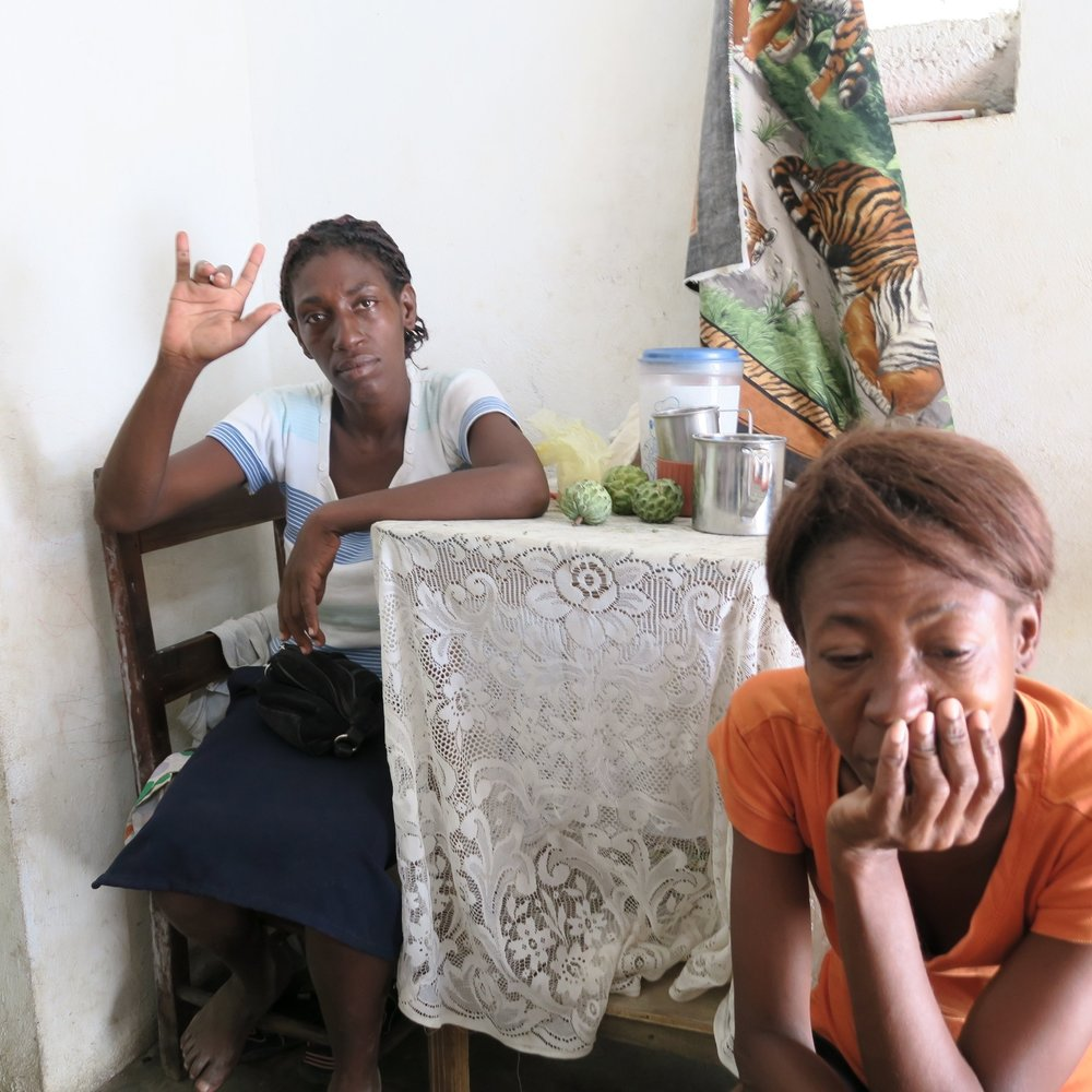 """Two Haitian children signing """"I love you.""""Redesigning for sustainability."""