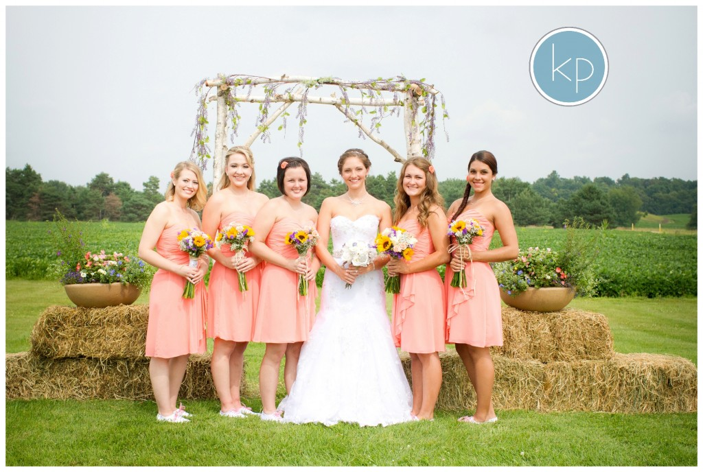 Bridesmaids posing with a bride at a lazy j ranch wedding by the alter