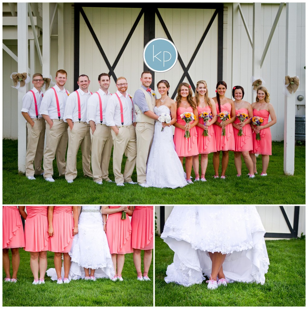 bride and groom posing with bridal party wearing pink dresses and pink spenders