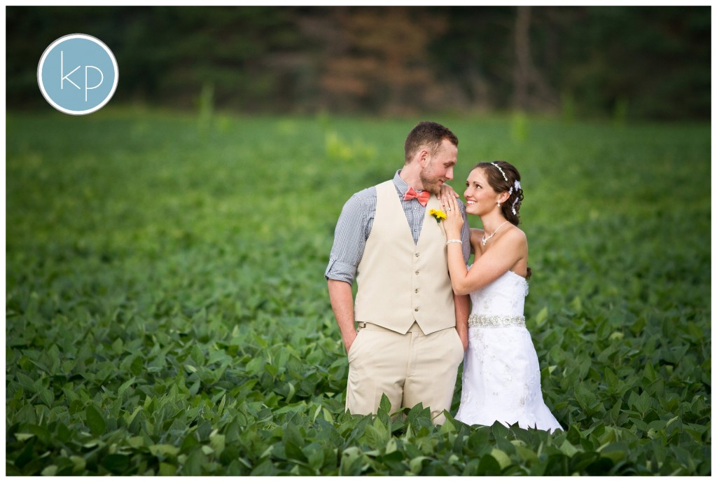 BRide smiling at groom in a soy bean field