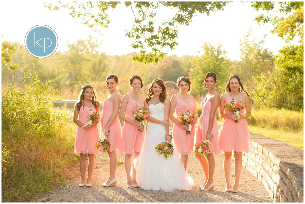 bride with bridesmaids posing