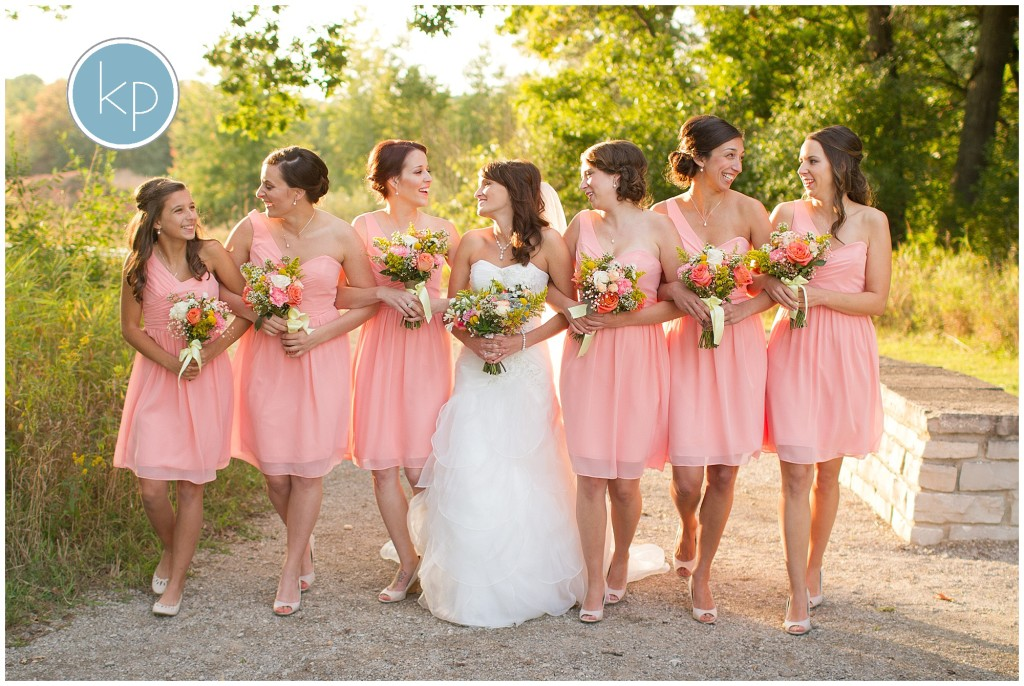 bride with her bridesmaids walking