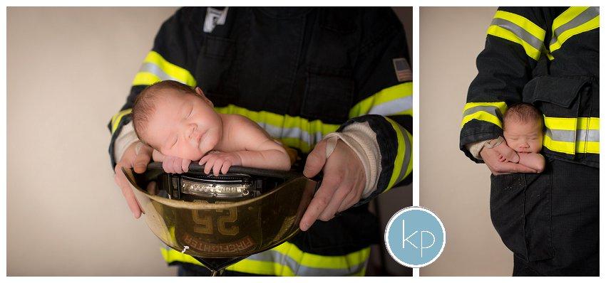 Baby in dad's fireman uniform, baby in pocket of fireman uniform