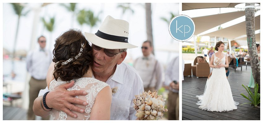 bride waiting to go down aisle, dad giving daughter kiss