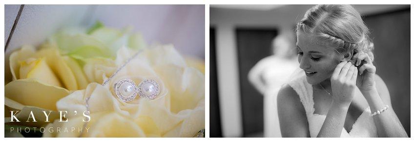 earrings on flowers, bride putting in those earrings