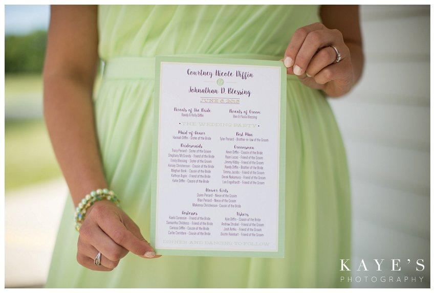 bridesmaid holding programs
