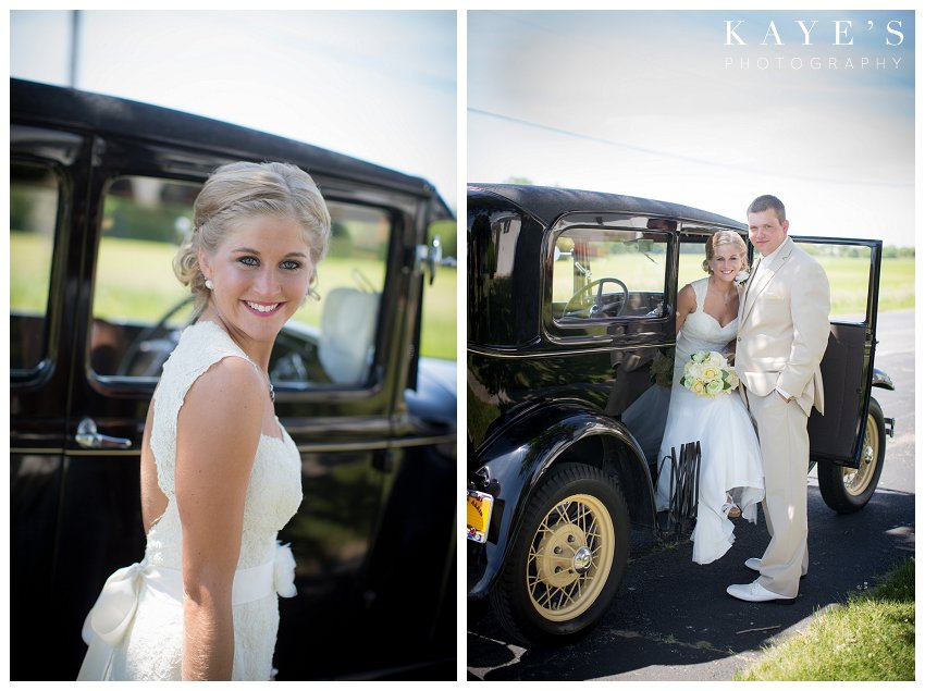 bride and groom posing with old car