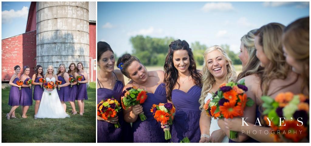 bride with bridesmaids, bride in front of barn
