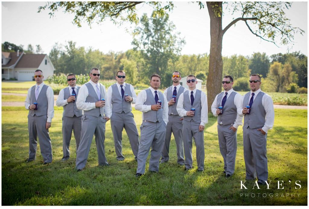 groom with groomsmen holding beers