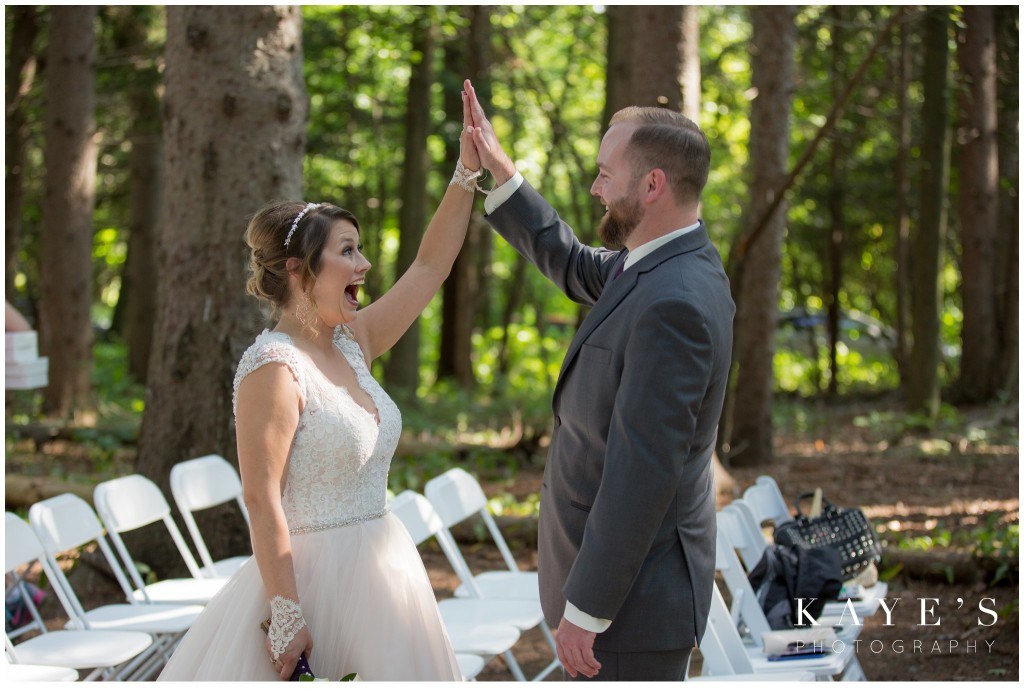 bride and groom high fiveing