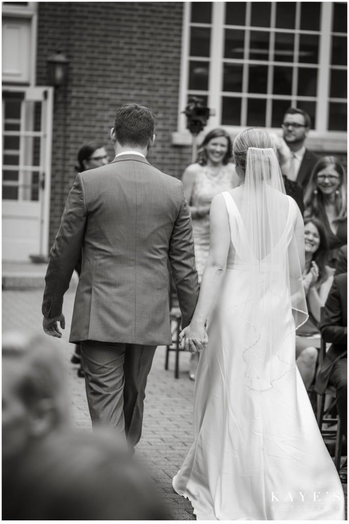 black and white, wedding, walking down isle, walking away