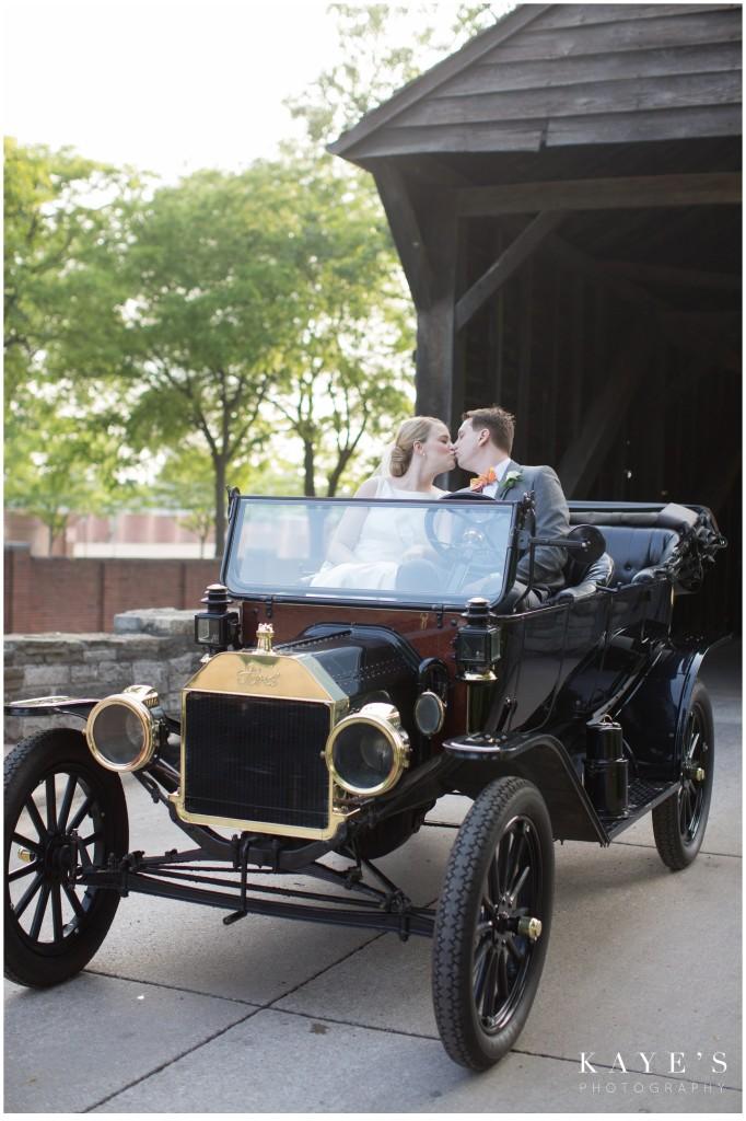 bride and groom kissing, old car, wedding, henry ford lovett