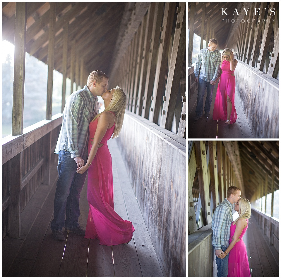 couple under bridge, couple in covered bridge, couple in frankenmuth, couple kissing