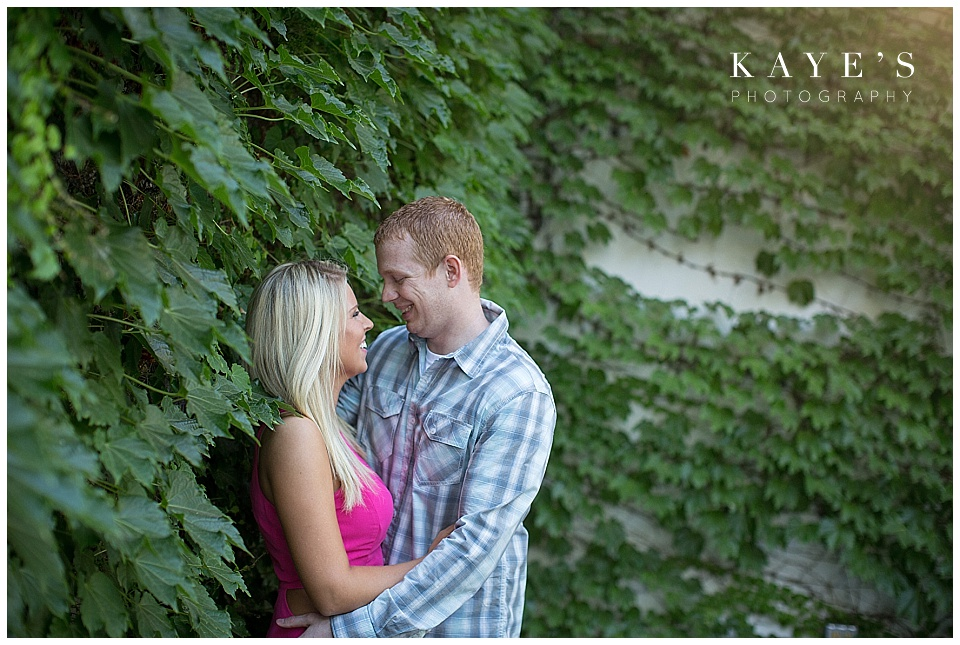 couple cuddling, couple with leaves, couple with ivy