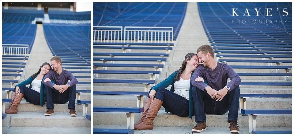 couple on bleachers, couple cuddling, U of M big house, U of M stadium, couple in stadium, michigan stadium