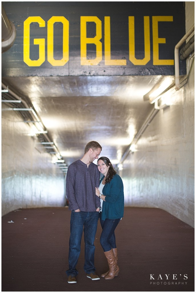 go blue, couple snuggling, couple in hallway, couple in tunnel