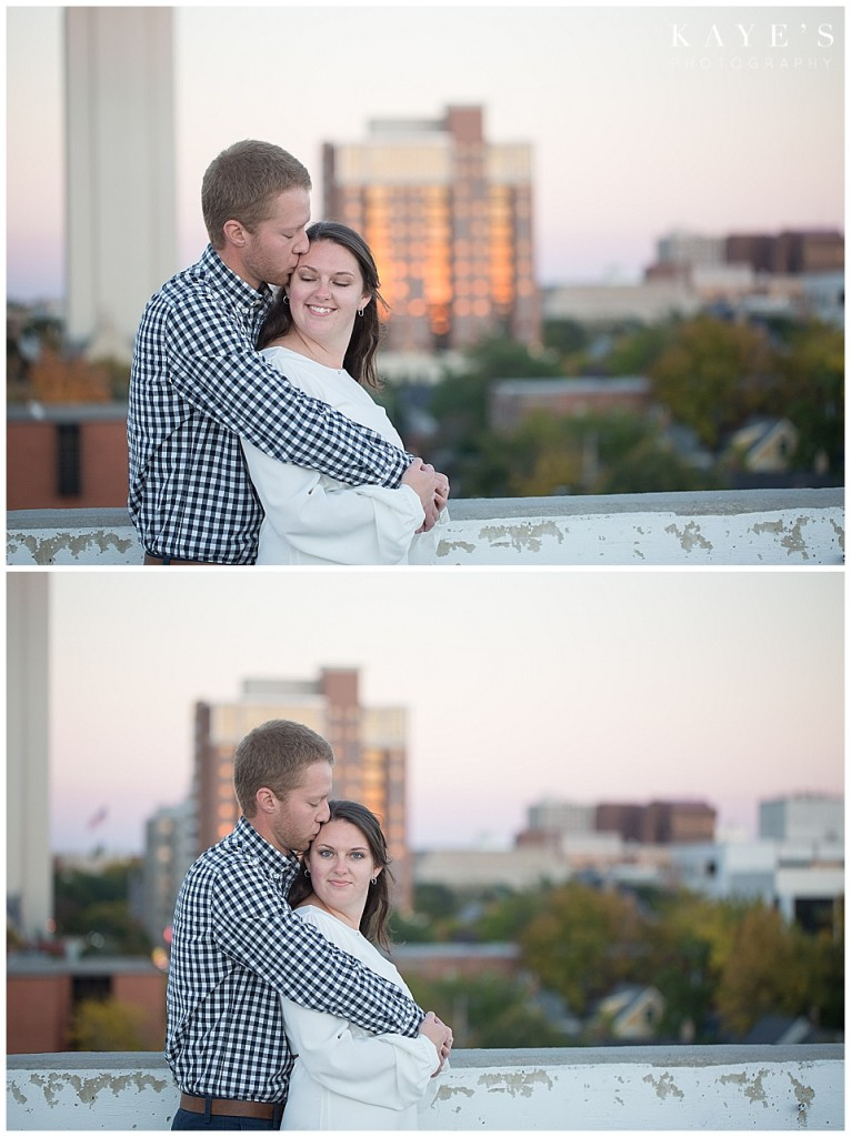 couple cuddling, skyline, ann arbor, groom kissing forehead