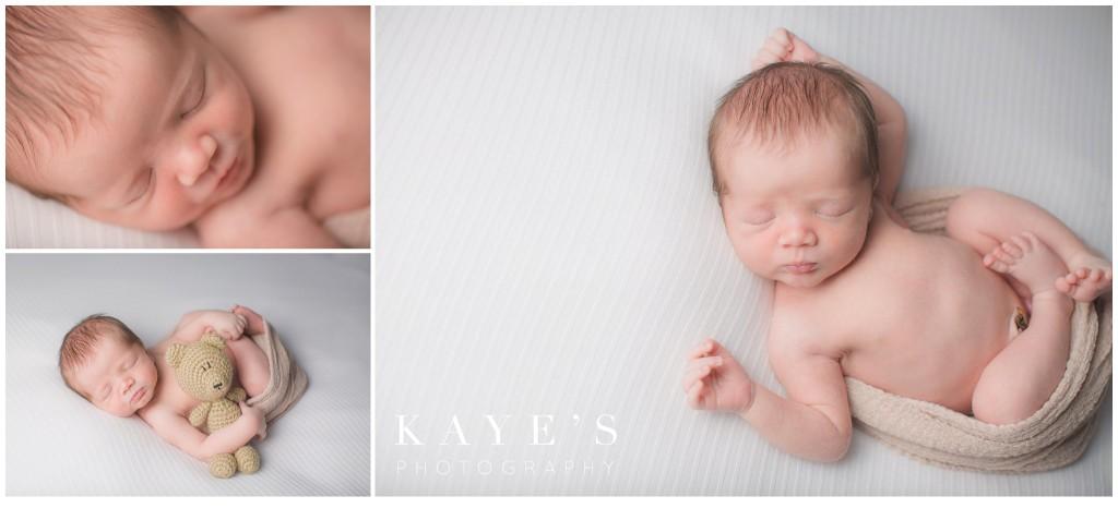 newborn on white, newborn closeup, newborn with bear
