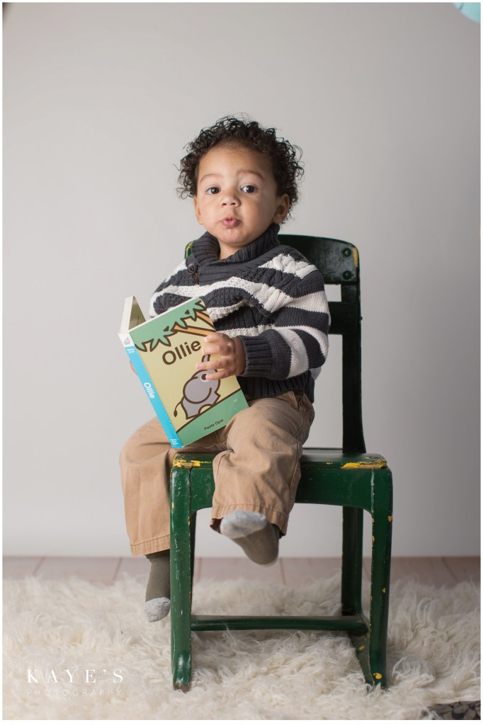 boy in chair, baby reading, closeup in chair