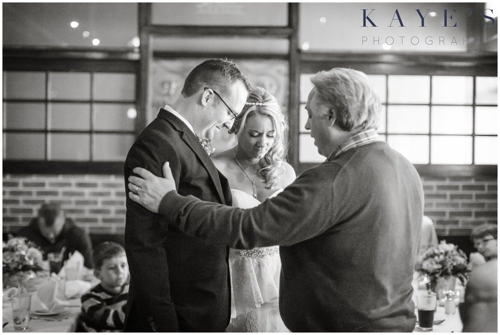 grand blanc wedding, grand blanc wedding portrait, grand blanc wedding photography ideas, bride and groom praying, bride and groom together, wedding dinner