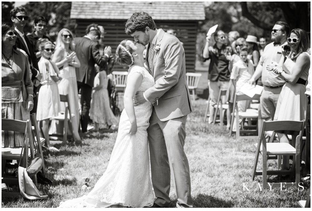 cobblestone farms ann arbor michigan wedding photographer, ann arbor michigan wedding photography, cobblestone farms wedding photos, ann arbor michigan wedding photographer ideas, bride and groom kissing, wedding portrait, bridal photography, walking out of the ceremony kiss