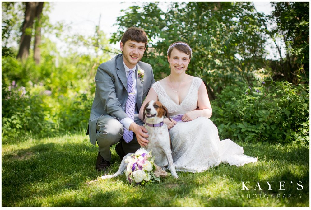 cobblestone farms ann arbor michigan wedding photographer, ann arbor michigan wedding photography, cobblestone farms wedding photos, ann arbor michigan wedding photographer ideas, bride and groom in grass, bride and groom with puppy, bride and groom with dog